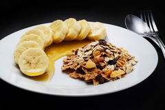 Cereal with banana topped with honey to health Royalty Free Stock Photo