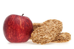 Cereal bar and apple Royalty Free Stock Image