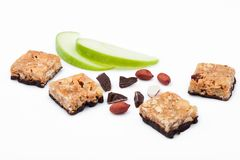 Cereal bar bits apple chocolate and peanuts Royalty Free Stock Photography