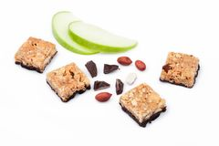 Cereal bar bits apple chocolate and peanuts Stock Photo