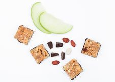 Cereal bar bits apple chocolate and peanuts Stock Image