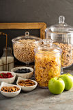 Cereal bar or buffet wih cornflakes, fruit and nuts Stock Photo