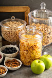 Cereal bar or buffet wih cornflakes, fruit and nuts Royalty Free Stock Image
