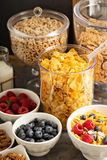 Cereal bar or buffet wih cornflakes, fruit and nuts Royalty Free Stock Photos
