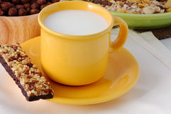 The cereal bar with cup of milk Royalty Free Stock Photos