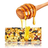 Cereal bar and honey Stock Photography