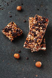 Cereal bar with nuts and chocolate Royalty Free Stock Photos