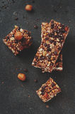 Cereal bar with nuts and chocolate Stock Photos
