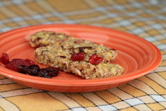 Cereal bars. With dried forest fruit on plate Stock Image