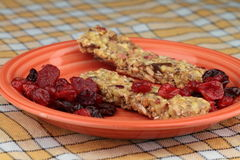 Cereal bars. With dried forest fruit on plate Stock Photography