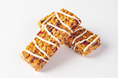 Cereal bars with wheat, cranberries and yogurt. Two cereal bars with wheat, cranberries and yogurt Royalty Free Stock Image