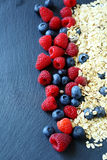 Cereal and blackberries on the slate Stock Photos