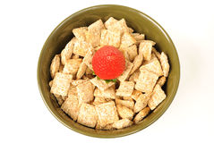 Cereal Bowl. Bowl of shredded wheat topped with a strawberry Stock Photography