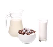 Cereal in bowl and glass jar with milk. Royalty Free Stock Photos