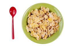 Cereal in the bowl with red spoon Royalty Free Stock Photo
