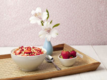 Cereal bowl with strawberres in a tray Stock Photo
