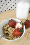 Cereal bowl with strawberry. Cereal bowl with fresh strawberry and milk Stock Photo