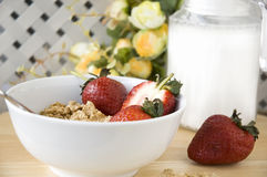 Cereal bowl on table. Cereal bowl with strawberry on table Royalty Free Stock Photo