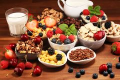 Cereal. Bowls of various cereals, berries and milk for breakfast. Muesli with kids cereals. Cereal. Bowls of various cereals, fruits and milk for breakfast stock photography
