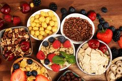 Cereal. Bowls of various cereals, berries and milk for breakfast. Muesli with kids cereals. Cereal. Bowls of various cereals, fruits and milk for breakfast stock images