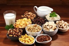 Cereal. Bowls of various cereals and milk for breakfast. Muesli with kids cereals. Cereal. Bowls of various cereals and milk for breakfast. Muesli with variety royalty free stock images