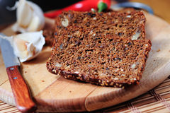 Cereal bread with garlic and pepper Stock Photography
