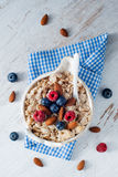 A cereal breakfast with berries and nuts Stock Photos