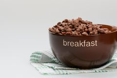 Cereal chocolate balls in bowl royalty free stock images