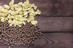 Cereal chocolate balls and corn flakes on wooden table Royalty Free Stock Photos