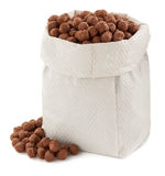 Cereal chocolate balls in paper bag Royalty Free Stock Photos
