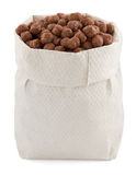 Cereal chocolate balls in paper bag Royalty Free Stock Image