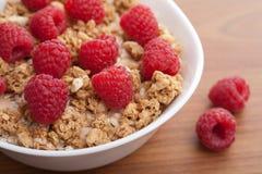 Cereal con las frambuesas Imagen de archivo libre de regalías