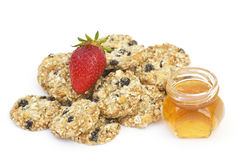 Cereal cookies, honey and fresh strawberry Royalty Free Stock Photo