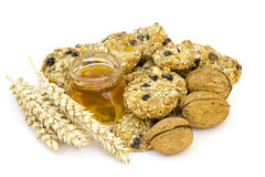 Cereal cookies, muesli, honey and nuts Stock Photos