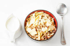 Cereal. Cornflake cereal in bowl, milk jar and spoon on white royalty free stock photos