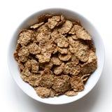 Cereal de café da manhã do farelo de trigo na bacia Fotos de Stock