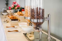 Cereal dispensers ,self service breakfast in  hotel. Cereal dispensers for self service breakfast in  hotel stock photography