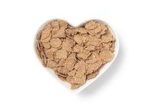 Cereal en forma de corazón del salvado del cuenco - imagen común Fotografía de archivo libre de regalías