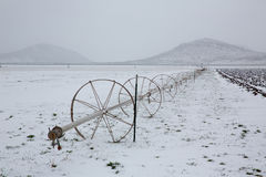 Cereal fields with irrigation wheels with snow in Nevada Stock Photos