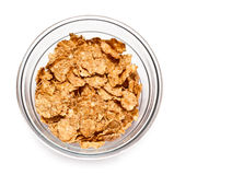 Cereal flakes. Corn flakes in a glass bowl on a white background Royalty Free Stock Photo