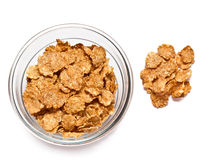 Cereal flakes. Corn flakes in a glass bowl on a white background Stock Photos