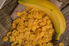 Cereal flakes and banana. Sugary cereal and banana in a rustic arrangement Stock Photo