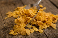 Cereal flakes and banana. Sugary cereal on a wooden background Royalty Free Stock Photography