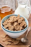 Cereal flakes in a bowl, milk and honey Stock Images