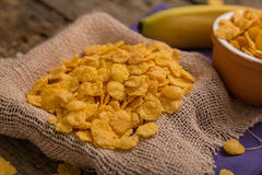 Cereal flakes. Sugary cereal in a rustic arrangement Stock Images