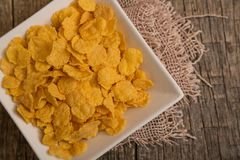 Cereal flakes. Sugary cereal on a wooden background Stock Photo