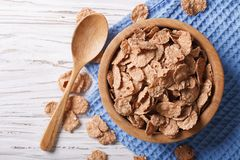 Cereal flakes in a wooden bowl. Horizontal top view Stock Image