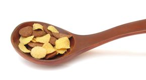 Cereal flakes on wooden spoon Royalty Free Stock Photo