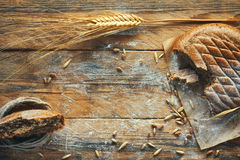 Cereal flapjack, ears of wheat and rye, corn, sprinkled flour. Cereal flapjack, ears of wheat and rye, corn, sprinkled with flour on old wooden table, rustic Royalty Free Stock Photos