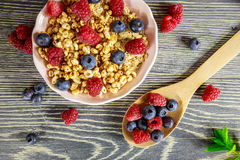 Cereal and fresh fruits. Arranged on a wooden table Royalty Free Stock Photo